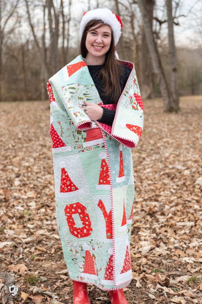 girl holding quilt outdoors