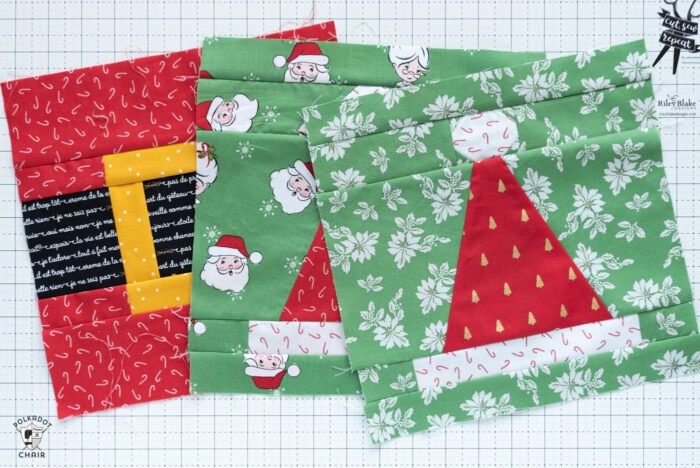 santa hat quilt blocks on white cutting mat