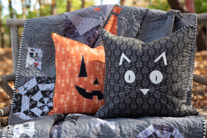 pillows and quilt on bench outdoors