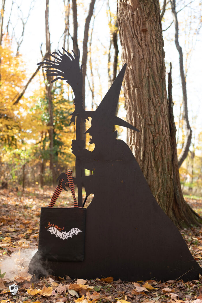 witch silhouette outdoors holding trick or treat bag
