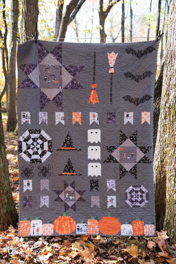 quilt on fence outdoors