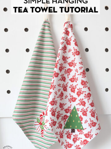 Two holiday tea towels on white table