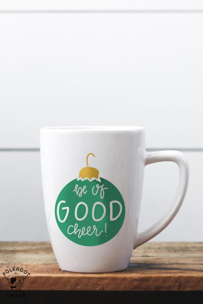 white coffee mug with green ornament