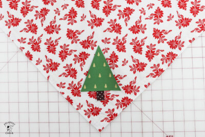 triangle christmas tree on fabric on cutting mat