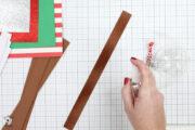 Spraying water on strip of brown paper