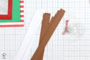 strips of paper on white cutting mat