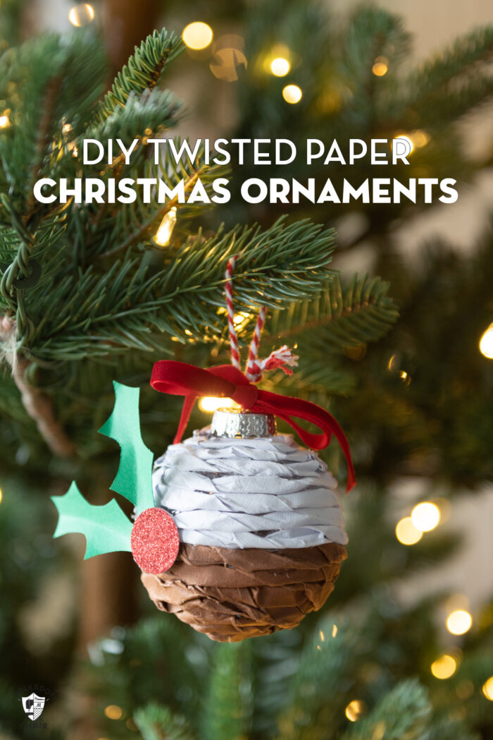 Twisted paper ornament hanging on Christmas tree