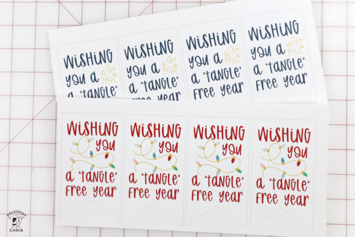 printed out gift tags on white cutting mat