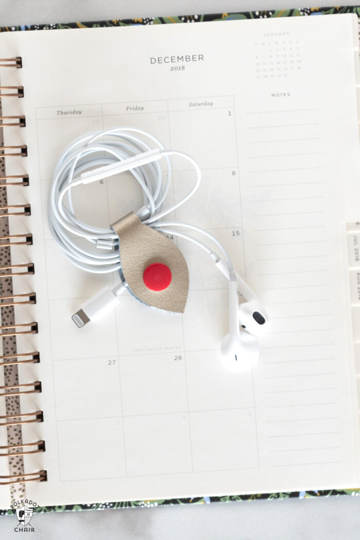 cord snaps around headphones on paper