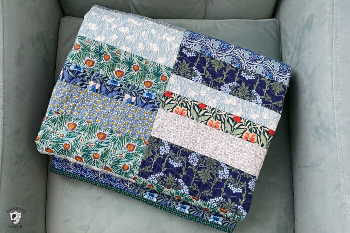 photo of a blue, green quilt on blue chair