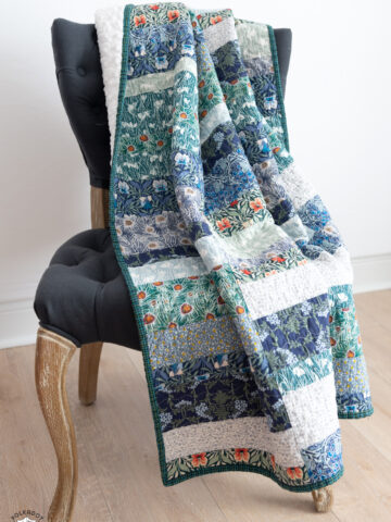 photo of a blue, green quilt on gray chair