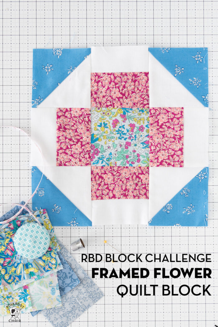 blue pink and floral quilt block on white cutting mat