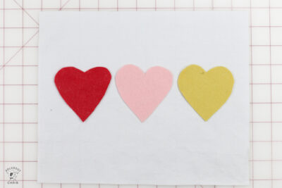 3 hearts on white canvas