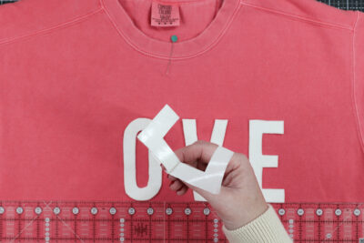 Love cut out on coral sweatshirt