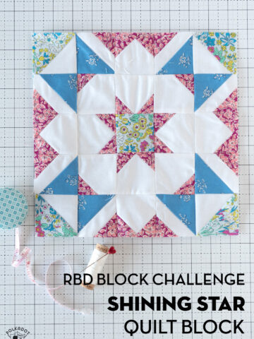 Blue, white and pink quilt block on white cutting mat
