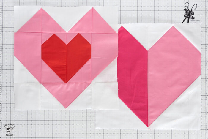 Pink and red heart quilt block on white cutting mat