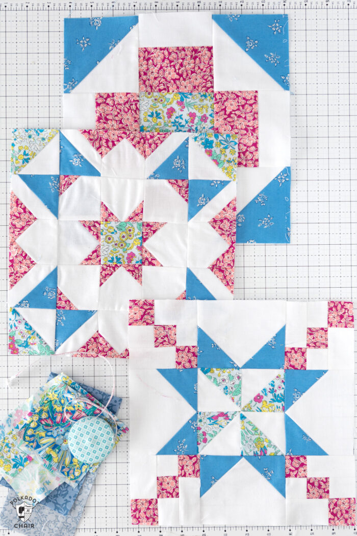 blue pink and floral quilt blocks on white cutting mat