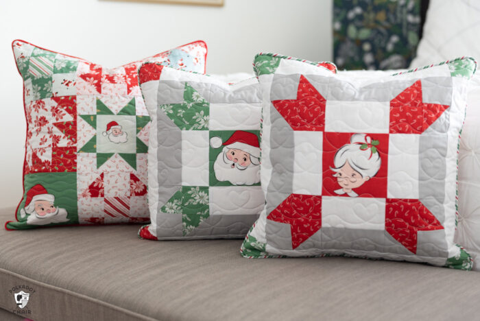 red, green and white patchwork christmas pillows on gray bench