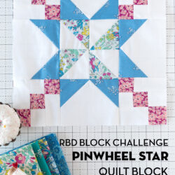 Blue, and pink quilt block from liberty of london fabrics on white cutting mat