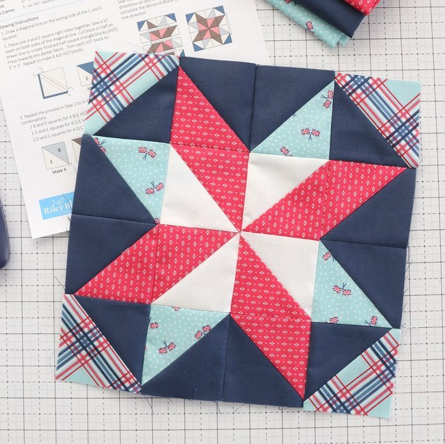 red white and blue quilt block on white cutting mat