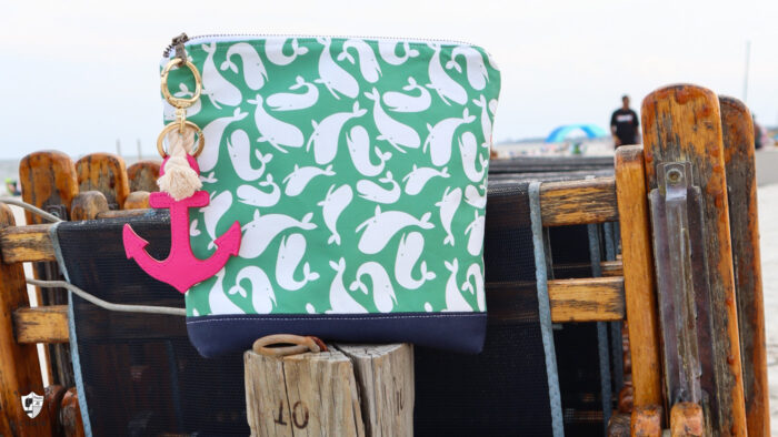 green nautical zip bag on beach