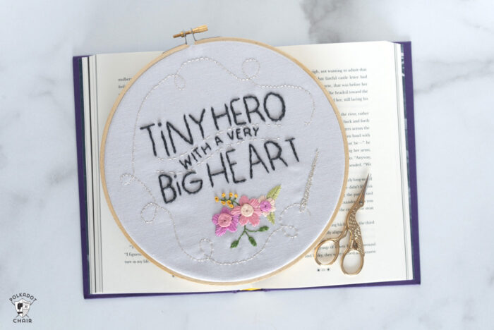 embroidery hoop on book with scissors