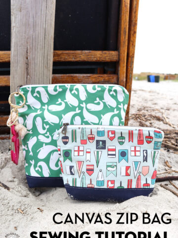 two nautical zip bags on beach