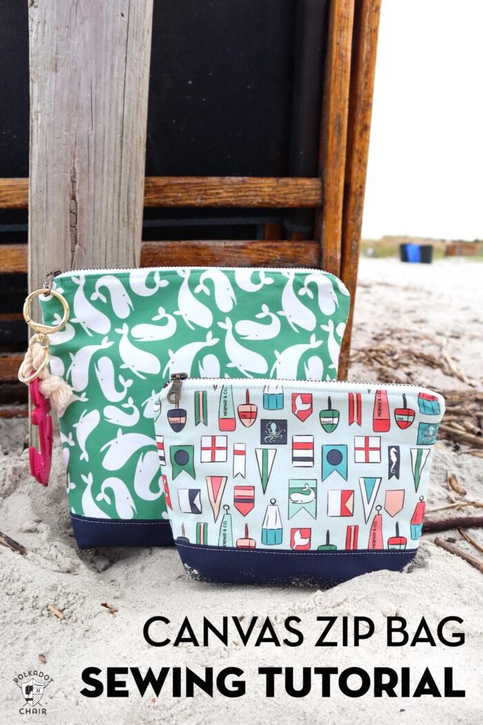two nautical zip bags on beach