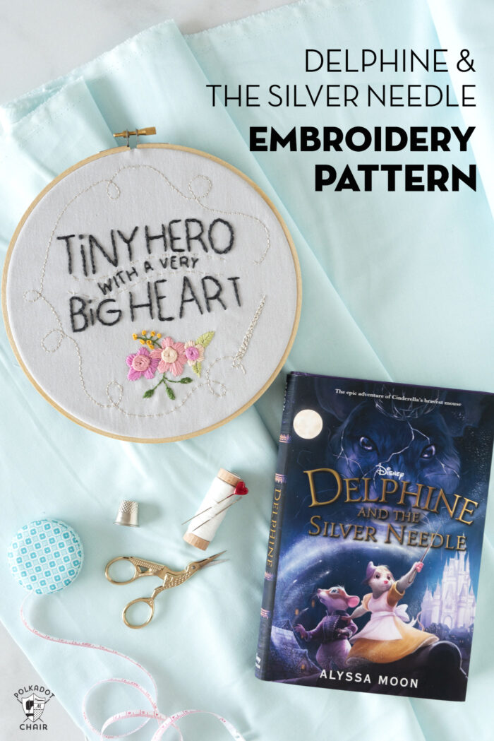 book and embroidery hoop on white table