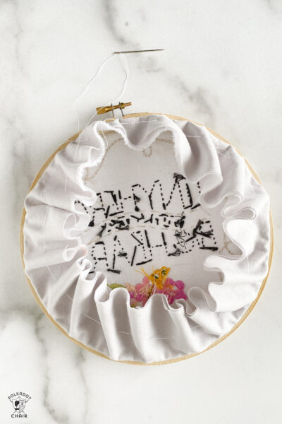 fabric gathered on the back of embroidery hoop