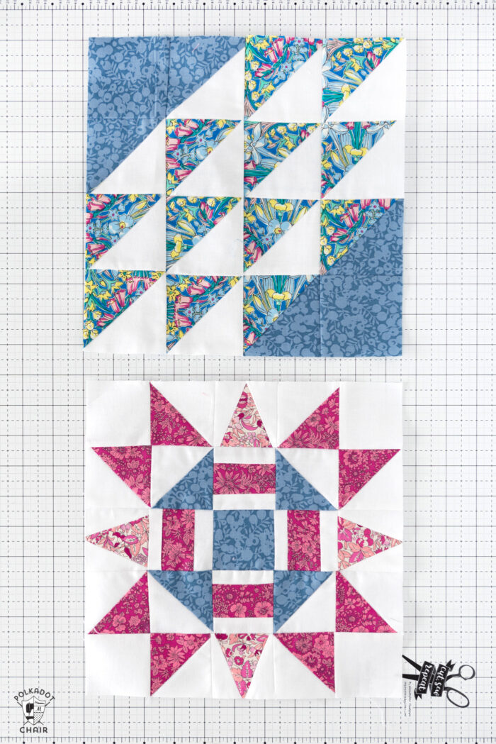 blue pink and white quilt blocks on a white cutting mat
