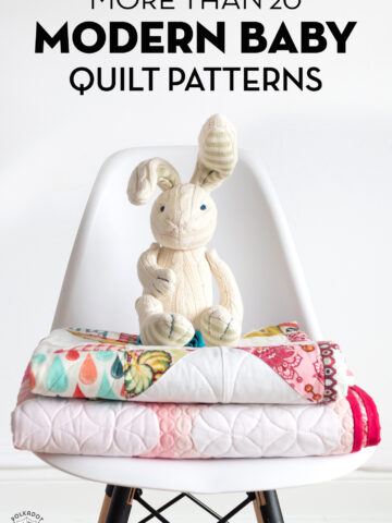 stack of quilts on chair with bunny in foreground