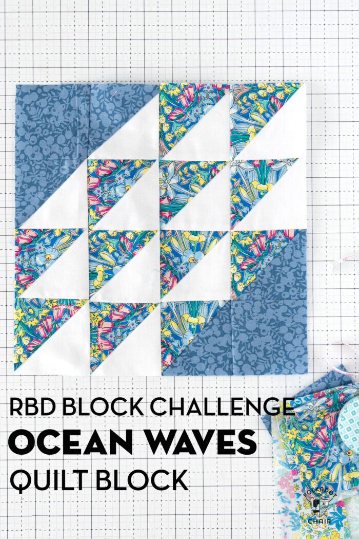 blue, yellow and white quilt block on white cutting mat