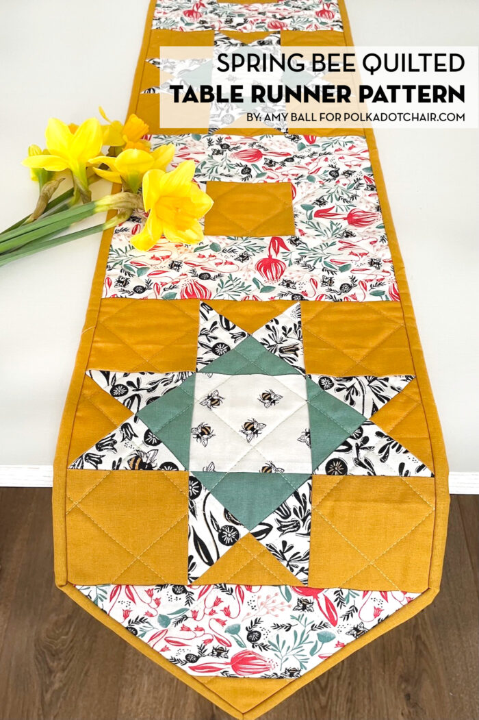 yellow, and green floral table runner on white table with flowers