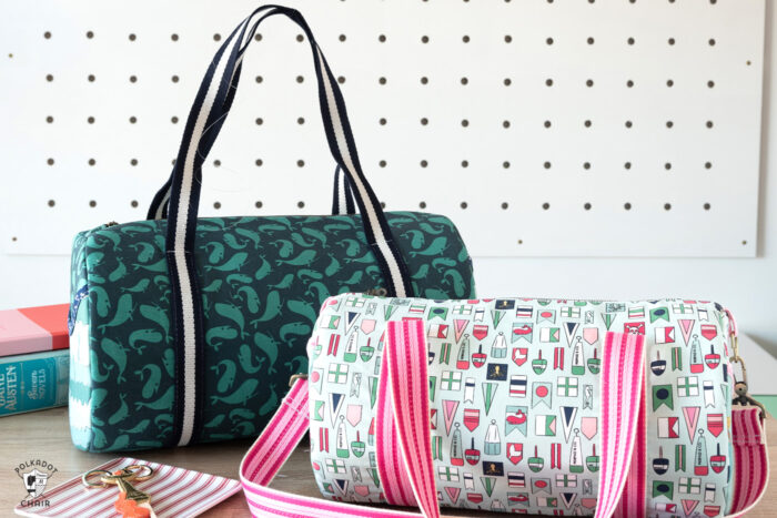 3 duffle bags on pegs in front of white wall