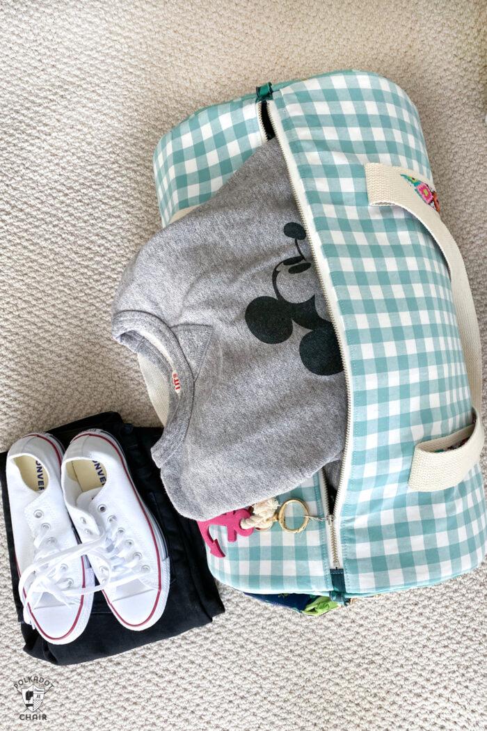 duffle bag on floor with sweatshirt