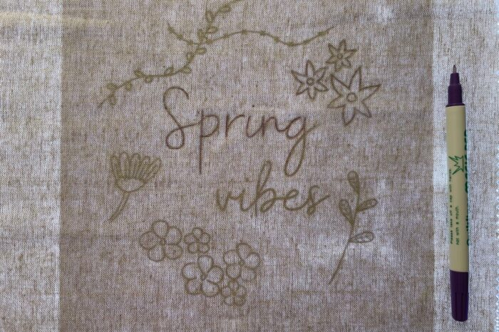 tracing embroidery pattern on fabric with lightbox