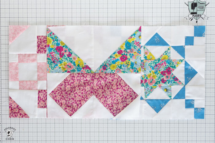 three colorful pieced quilt blocks on white cutting mat