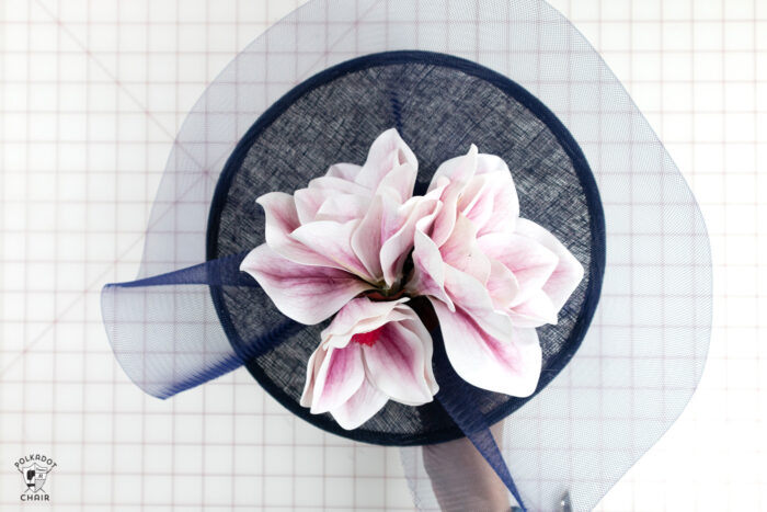 navy fascinator with pink flowers glued on
