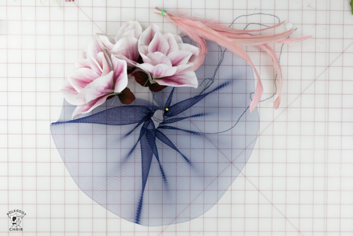 navy tulle and pink flowers on white cutting mat