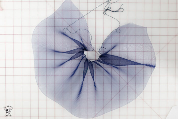 navy tulle on white cutting mat