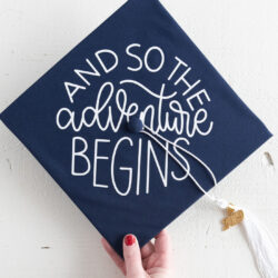 navy blue graduation cap with white lettering
