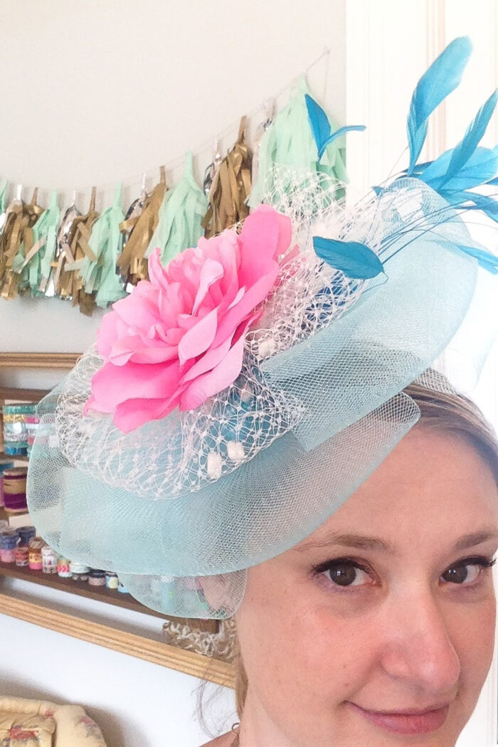 woman wearing pink and light blue fascinator
