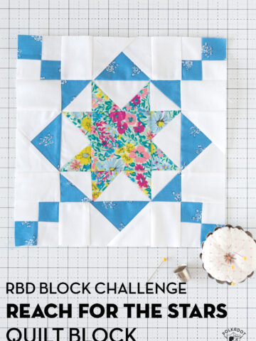 blue white and floral quilt block on white cutting mat