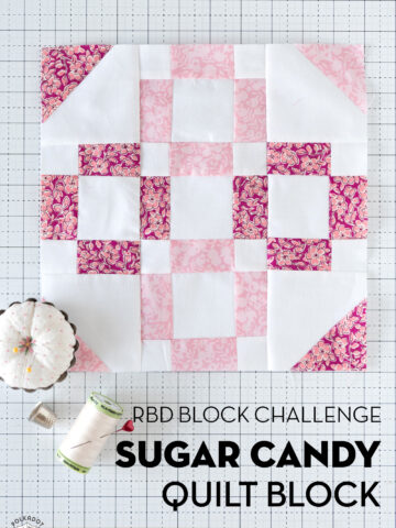 pink quilt block on white cutting mat