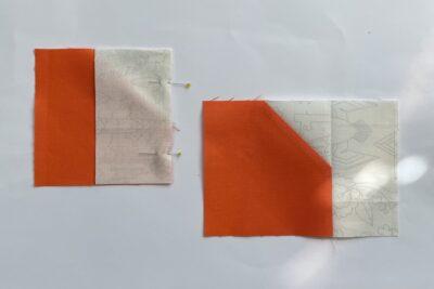 cut orange and cream fabric on white table