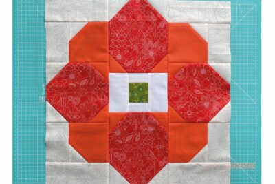 patchwork flower in pieces on cutting mat