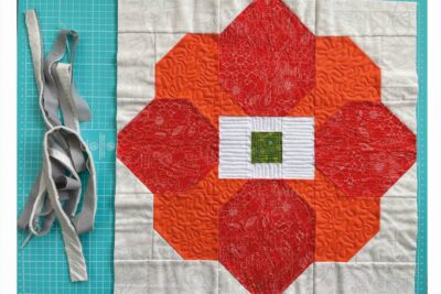 quilted patchwork flower on cutting mat