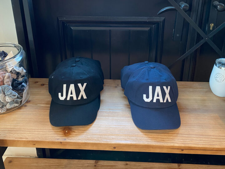 Two hats with JAX lettering