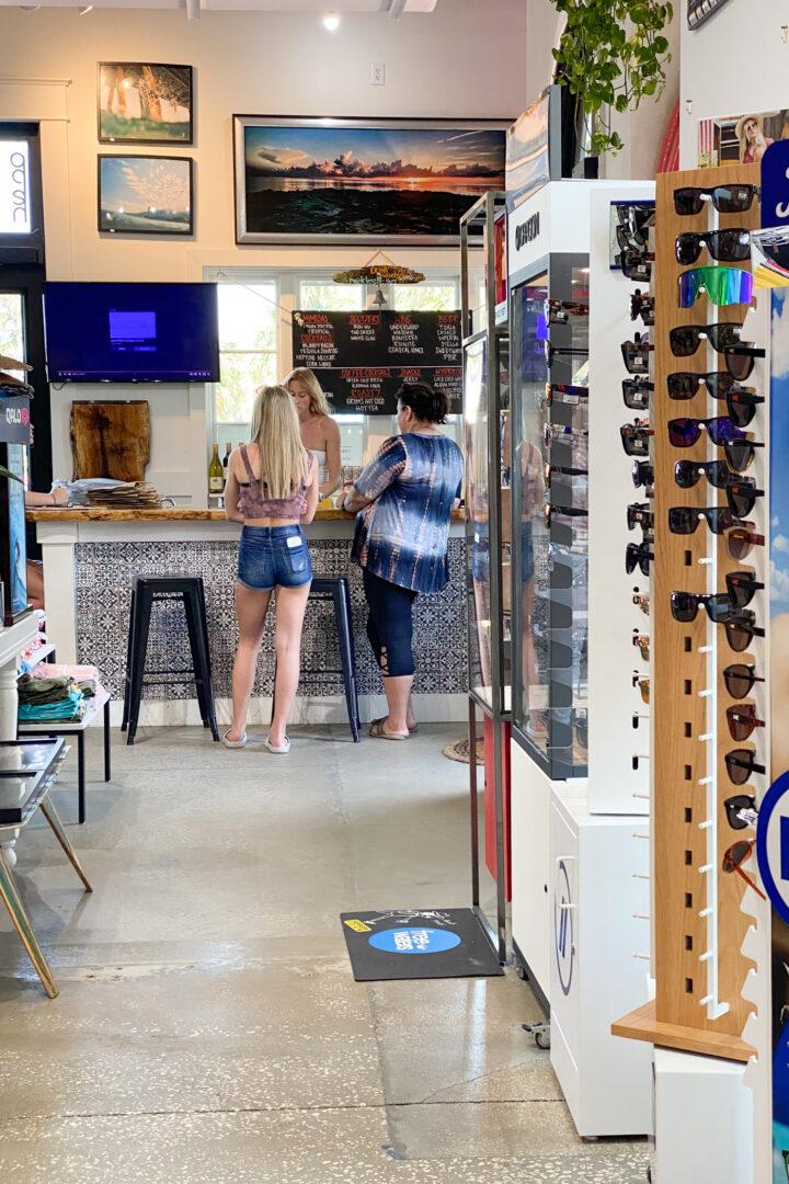 3 people inside shop